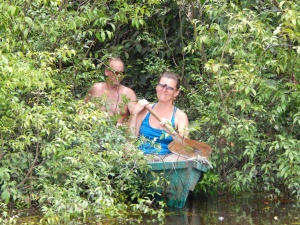 Jenni and Corey canoeing in the jungle