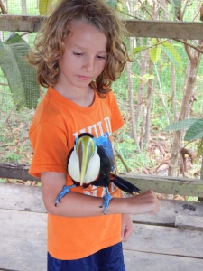 Oliver holding a rescued toucan.